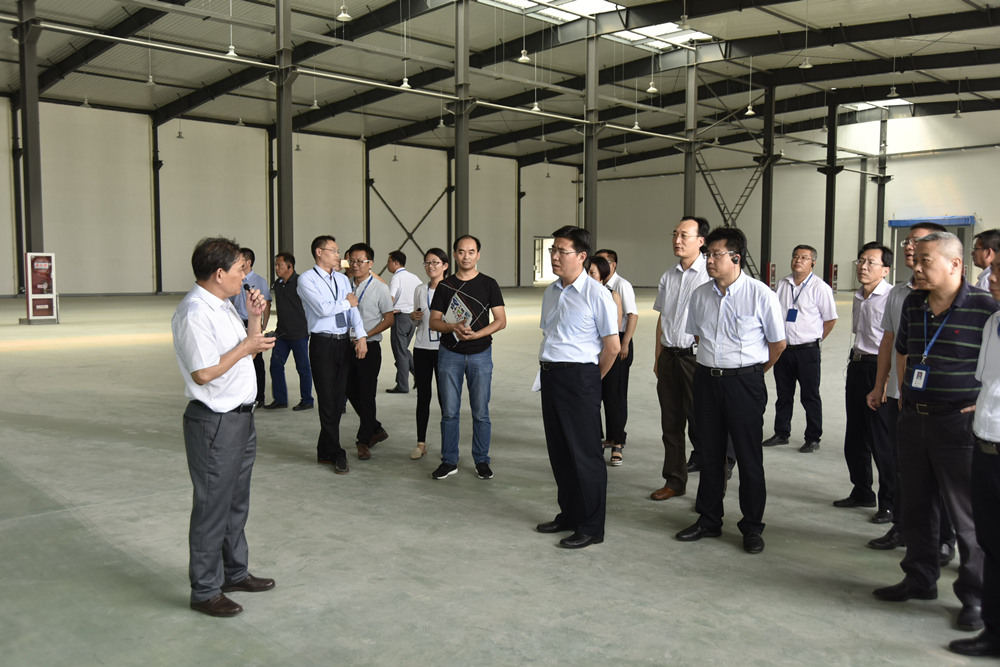 Cao weidong and his delegation from lianyungang economic development zone came to lianyungang branch for inspection and guidance